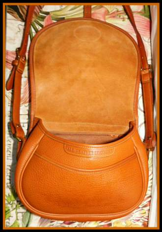 Vintage Dooney Bourke All-Weather Leather Saddle Bag