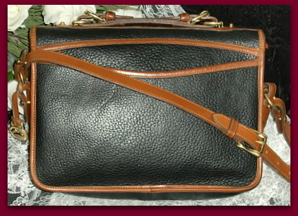 Vintage Dooney and Bourke  All-Weather Leather® Collection   Carrier Shoulder Bag 701 Black and Tan