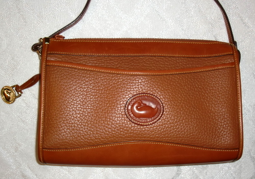 SOLD!!! Dooney & Bourke Zipper Clutch Crossbody/Shoulder Bag in Rare Peanut Color-Dooney and Bourke, Zipper, zip top, zip top dooney, peanut color dooney, peanut color purse, brown leather purse, brown dooney, Crossbody, Shoulder Bag, Dooney Bourke All Weather Leather, R20,  Zipper Clutch Bag,  Vintage, All Weather Leather Dooney and Bourke,Rare Peanut Color  , British Tan Trim,AWL Bag, duck seal, duck fob, brass duck fob, adjustible strap, leather awl, popcled awl bag, zip top, zip top dooney, dooney handbag  , nopin