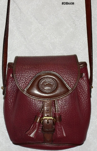 SOLD! Mint Dooney & Bourke AWL Rouge & Chocolate Crossbody Purse-Dooney & Bourke, AWL, Rouge & Chocolate Crossbody Purse, Dooney & Bourke, AWL,  Rouge & Chocolate, Rare & Impressive, clutch purse, removable strap, buckle, tassels, leather dooney purse, dooney duck, duck fob, 100% genuine, burgundy color, cedar, small leather purse, collectible, vintage, vintage purse, excellent condition, rare, vintage rouge, vintage dooney, vintage clutch, nopin