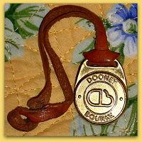 Very Vintage Dooney DB Brass FOB