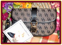 Alluring New Black Signature Anniversary Wristlet By Dooney Bourke