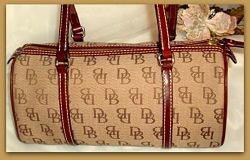 Sophisticated Dooney Bourke Signature Canvas Barrel Bag