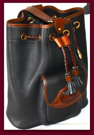 Dooney and Bourke  All Weather Leather   Large Vintage Dooney Drawstring Sling Bag