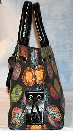 Dooney and Bourke  Coated Canvas Medallion IT Collection  Tassel Tote Bag