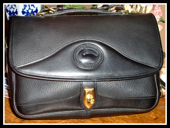 SOLD! Black Carrier by Dooney & Bourke Mint Condition!
